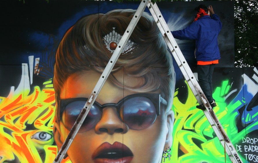 An Artist Draws Rihanna at Grafitti Zone Photo by Robin Elizabeth Herr