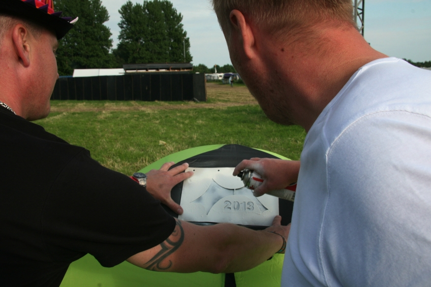 Fans branding their tent with 2013 Logo Photo by Robin Elizabeth Herr